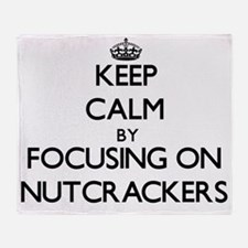 Keep Calm by focusing on Nutcrackers Throw Blanket