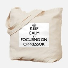 Keep Calm by focusing on Oppressor Tote Bag
