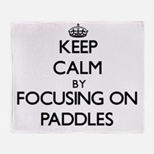 Keep Calm by focusing on Paddles Throw Blanket