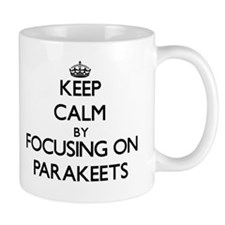 Keep Calm by focusing on Parakeets Mugs