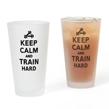 Keep calm and train hard Drinking Glass