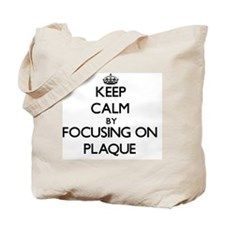 Keep Calm by focusing on Plaque Tote Bag