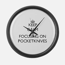 Keep Calm by focusing on Pocketkn Large Wall Clock