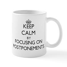Keep Calm by focusing on Postponements Mugs