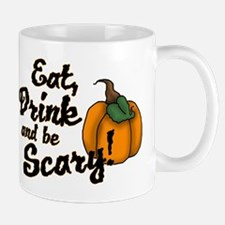 eat drink and be scary Mugs
