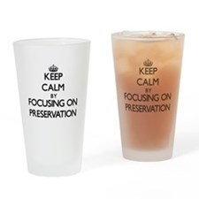 Keep Calm by focusing on Preservati Drinking Glass
