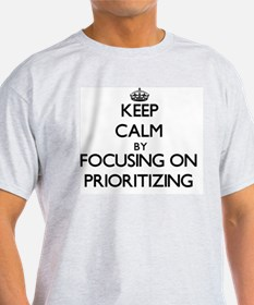 Keep Calm by focusing on Prioritizing T-Shirt