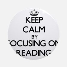 Keep Calm by focusing on Reading Ornament (Round)