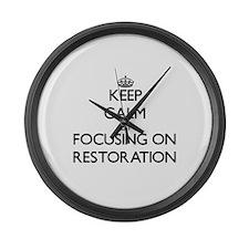 Keep Calm by focusing on Restorat Large Wall Clock
