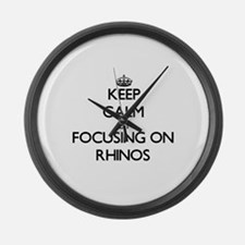 Keep Calm by focusing on Rhinos Large Wall Clock