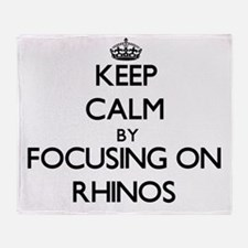 Keep Calm by focusing on Rhinos Throw Blanket