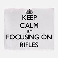 Keep Calm by focusing on Rifles Throw Blanket