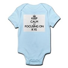 Keep Calm by focusing on Rye Body Suit