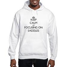 Keep Calm by focusing on Saddles Hoodie