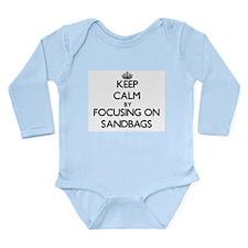Keep Calm by focusing on Sandbags Body Suit