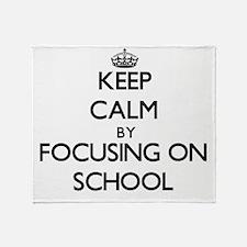 Keep Calm by focusing on School Throw Blanket