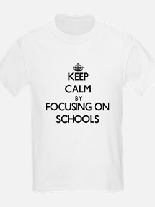 Keep Calm by focusing on Schools T-Shirt