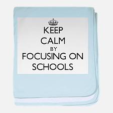 Keep Calm by focusing on Schools baby blanket