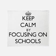 Keep Calm by focusing on Schools Throw Blanket