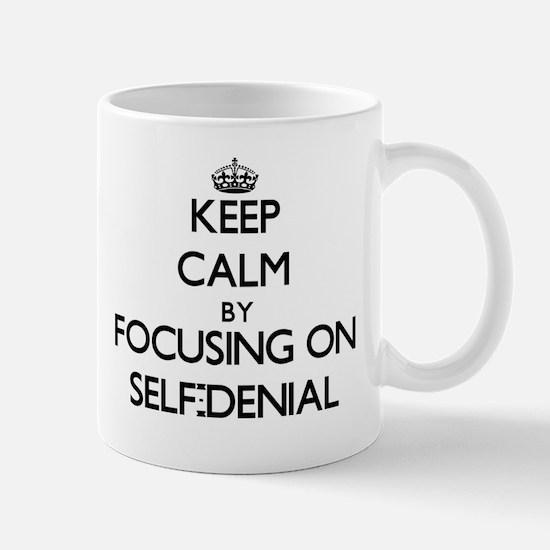 Keep Calm by focusing on Self-Denial Mugs
