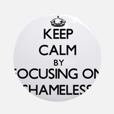 Keep Calm by focusing on Shameles Ornament (Round)
