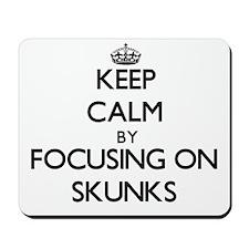 Keep Calm by focusing on Skunks Mousepad