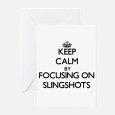 Keep Calm by focusing on Slingshots Greeting Cards