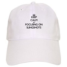 Keep Calm by focusing on Slingshots Baseball Cap