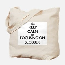 Keep Calm by focusing on Slobber Tote Bag