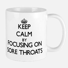 Keep Calm by focusing on Sore Throats Mugs