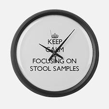 Keep Calm by focusing on Stool Sa Large Wall Clock
