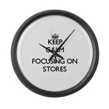 Keep Calm by focusing on Stores Large Wall Clock