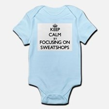 Keep Calm by focusing on Sweatshops Body Suit