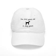 85 dog years black dog 2 Baseball Baseball Cap