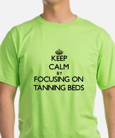 Keep Calm by focusing on Tanning Beds T-Shirt