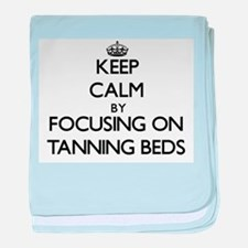 Keep Calm by focusing on Tanning Beds baby blanket