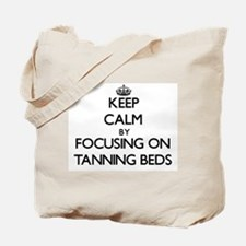 Keep Calm by focusing on Tanning Beds Tote Bag