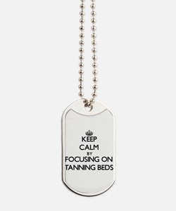 Keep Calm by focusing on Tanning Beds Dog Tags
