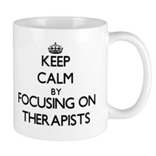 Keep Calm by focusing on Therapists Mugs