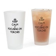 Keep Calm by focusing on Torches Drinking Glass