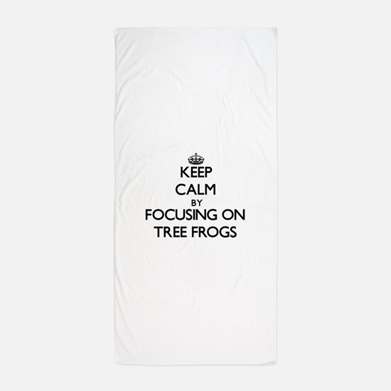Keep Calm by focusing on Tree Frogs Beach Towel