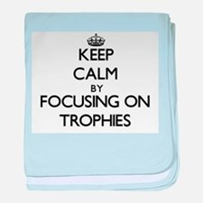 Keep Calm by focusing on Trophies baby blanket