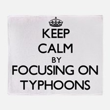 Keep Calm by focusing on Typhoons Throw Blanket
