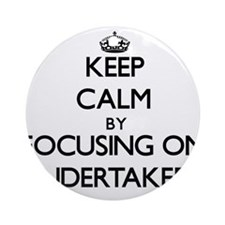 Keep Calm by focusing on Undertak Ornament (Round)