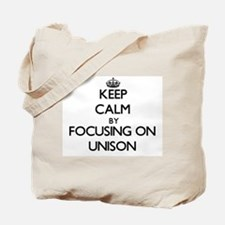 Keep Calm by focusing on Unison Tote Bag