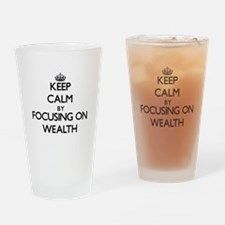 Keep Calm by focusing on Wealth Drinking Glass
