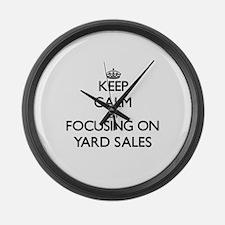 Keep Calm by focusing on Yard Sal Large Wall Clock