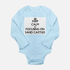 Keep Calm by focusing on Sand Castles Body Suit