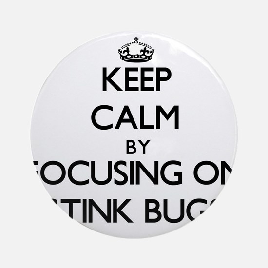 Keep Calm by focusing on Stink Bu Ornament (Round)