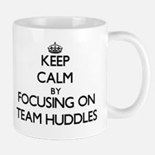 Keep Calm by focusing on Team Huddles Mugs